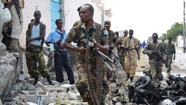 Somali soldiers patrol after al Qaeda-linked insurgents shoot their way into the U.N. compound in Mogadishu on June 19.