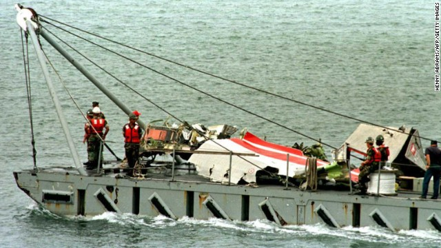 File image from 1996 shows wreckage from TWA's flight 800 being taken to Shinnecock, New York, Coast Guard Station.
