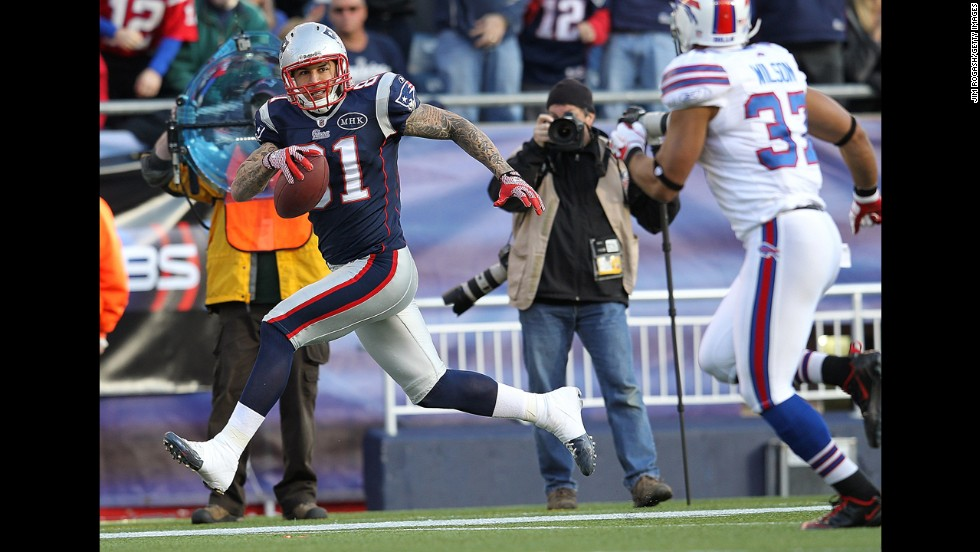 Hernandez scores a touchdown against the Buffalo Bills on January 1, 2012. Hernandez played three seasons with the Patriots, catching 18 touchdowns.