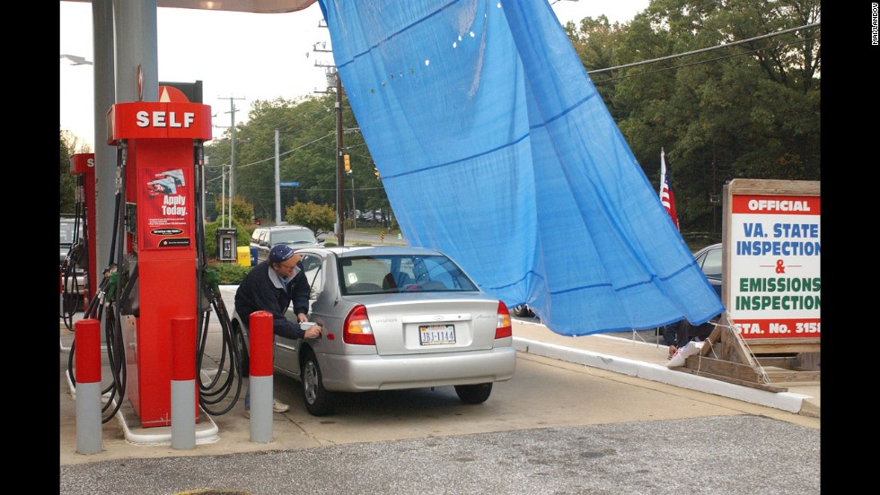 A tarp was hung at this Texaco gas station in Virginia to keep the sniper from targeting potential victims.