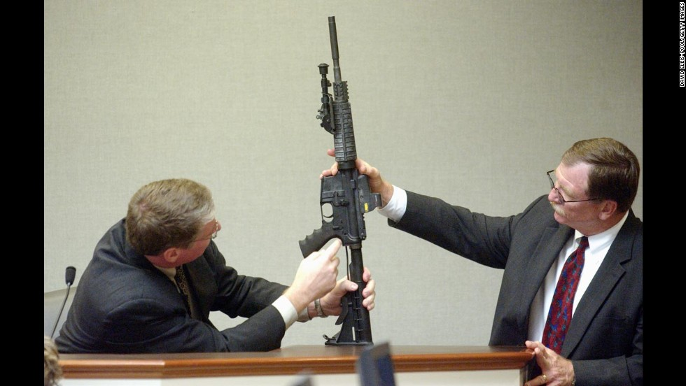 During court proceedings in November 2003, Timothy Curtis points out features on a Bushmaster rifle said to have been used by Muhammad.