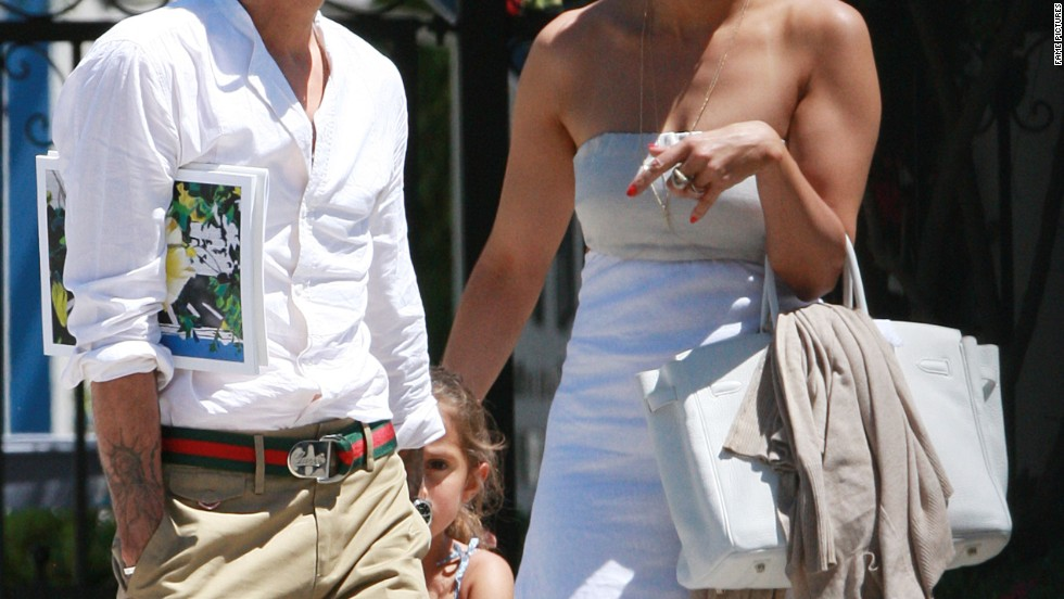 Jennifer Lopez laughs with her ex-husband and daughter while out in Los Angeles on June 19.