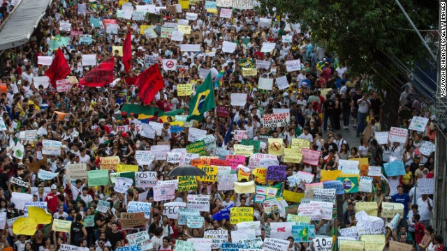 Thousands of people march in the center of Recife, state of Pernambuco, Brazil, on June 20, 2013, during a protest of what is now called the 'Tropical Spring' against corruption and price hikes. Brazilians took to the streets again on a new day of mass nationwide protests, demanding better public services and bemoaning massive spending to stage the World Cup. More than one million people have pledged via social media networks to march in 80 cities across Brazil, as the two-week-old protest movement -- the biggest seen in the South American country in 20 years -- showed no sign of abating. AFP PHOTO / YASUYOSHI CHIBA (Photo credit should read YASUYOSHI CHIBA/AFP/Getty Images)