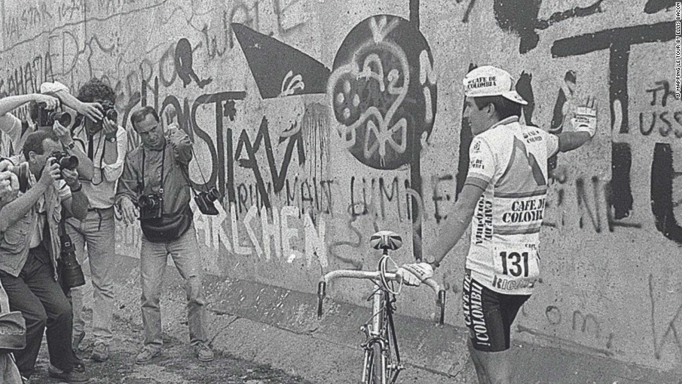 Colombian rider Luis Herrera at the Berlin Wall in 1987 as the Tour spent three days in the still divided country of Germany that year.