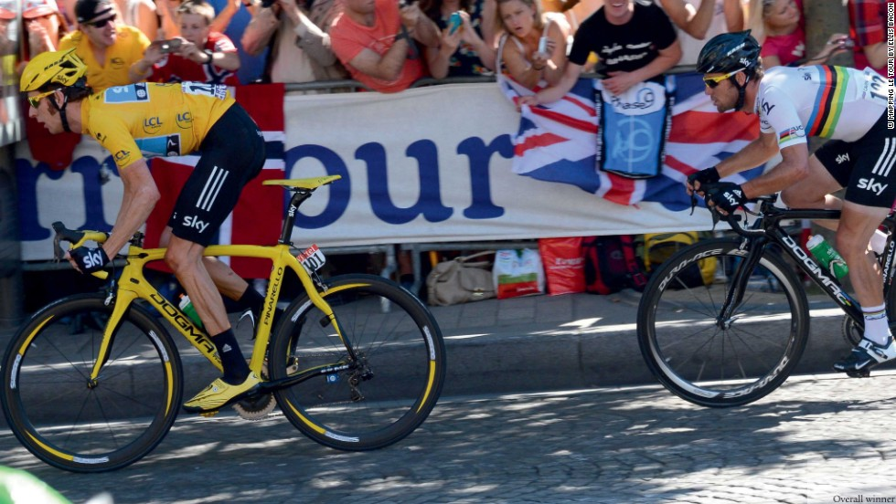 2012 winner Wiggins leads out his Sky teammate and compatriot Mark Cavendish on the Champs Elysees. Sprinting ace Cavendish went on to claim his 23rd stage win on the Tour de France.