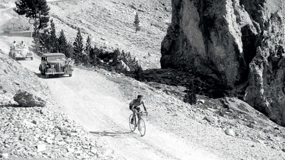 Legendary Italian rider Gino Bartali rides in splendid isolation on the Col d'Izoard on his way to victory on the 14th stage and his first overall triumph in the iconic classic.