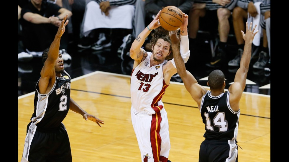 Kawhi Leonard and Gary Neal of the San Antonio Spurs pressure Mike Miller of the Miami Heat.