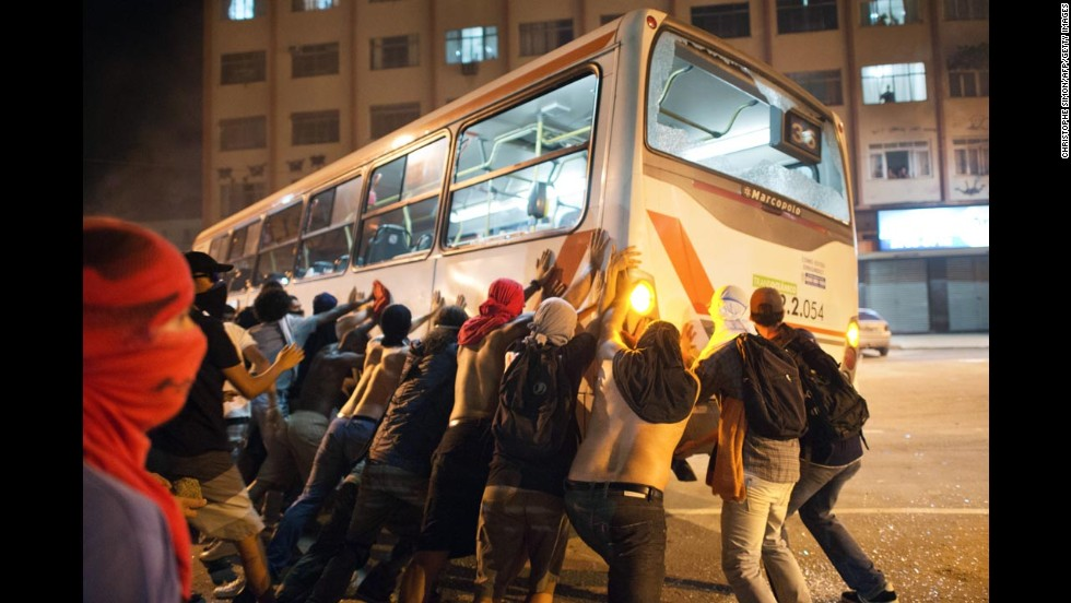 Protesters overturn a bus in Niteroi on June 19.