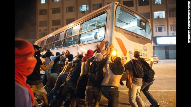 Protesters overturn a bus in Niteroi, on June 19.