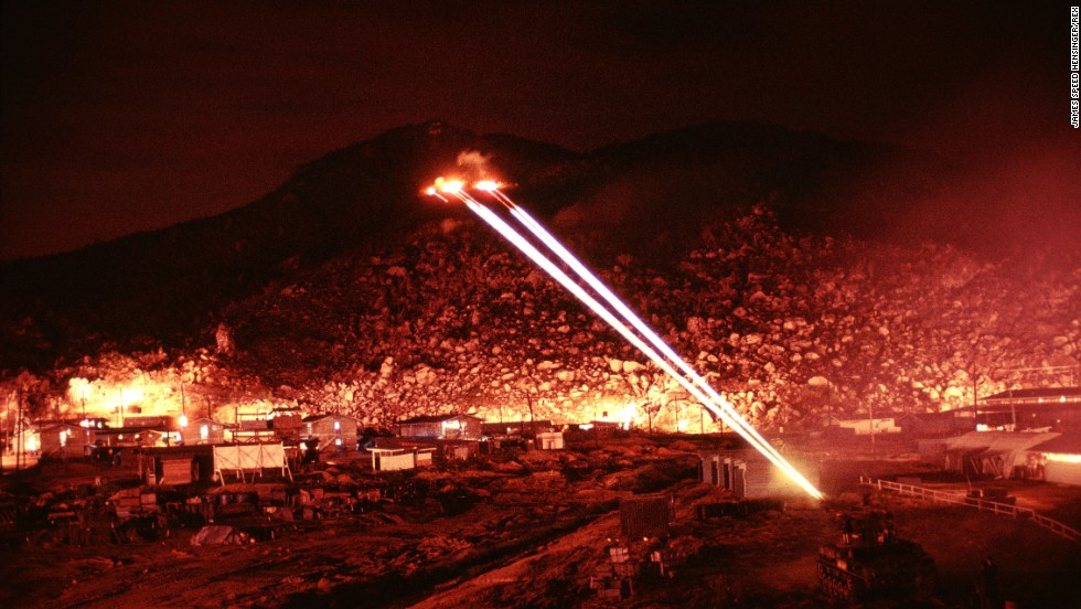 Hensinger used a long exposure to capture the firefight, resulting in dramatic images of the path of tracer and heavy artillery fire.