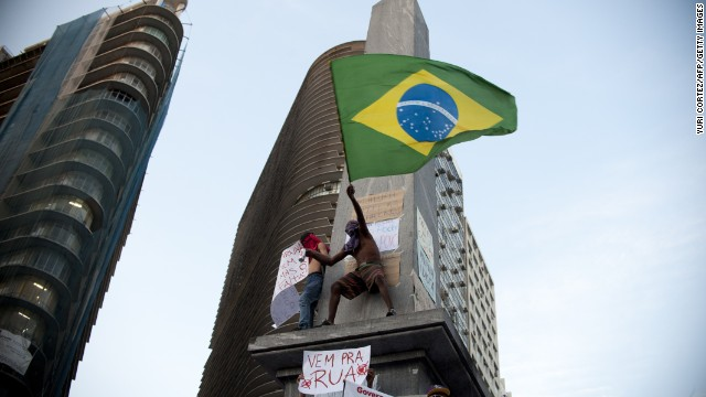 A demonstrator waves the Brasilian national flag during a protest part of what is now called the 'Tropical Spring' against corruption and price hikes, on June 20, 2013, in Belo Horizonte, Brasil. Brazilians took to the streets again Thursday in several cities on a new day of mass nationwide protests, demanding better public services and bemoaning massive spending to stage the World Cup. More than one million people have pledged via social media networks to march in 80 cities across Brazil, as the two-week-old protest movement -- the biggest seen in the South American country in 20 years -- showed no sign of abating. AFP PHOTO / Yuri CORTEZ (Photo credit should read YURI CORTEZ/AFP/Getty Images)