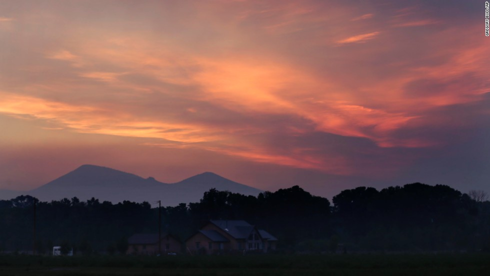 Smoke fills the sky as dawn breaks near South Fork, Colorado, on Saturday, June 22.
