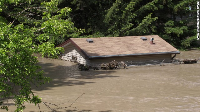 A house is submerged by flood water at a park near the Bow River in Calgary, Alberta, Canada June 22, 2013. Water levels have dropped slightly today. AFP PHOTO/DAVE BUSTON (Photo credit should read DAVE BUSTON/AFP/Getty Images)