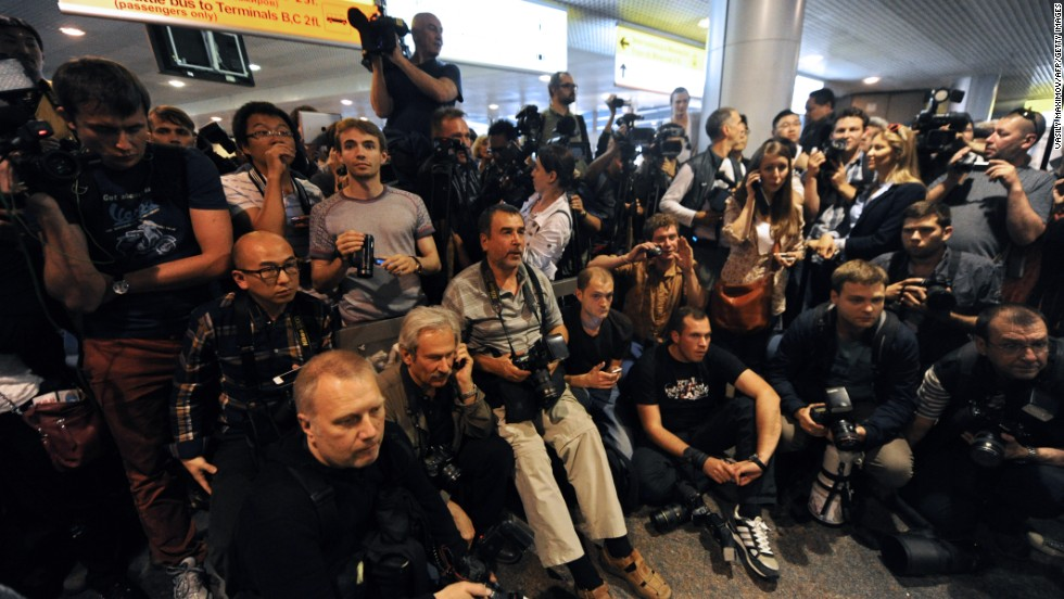 Journalists wait for any sign of Snowden or those who are trying to help him in front of the airport on on June 23, 2013. He has not been spotted yet.