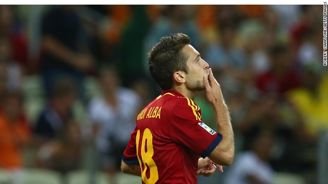 Jordi Alba wheels away in celebration after scoing his second goal and Spain's third against Nigeria.