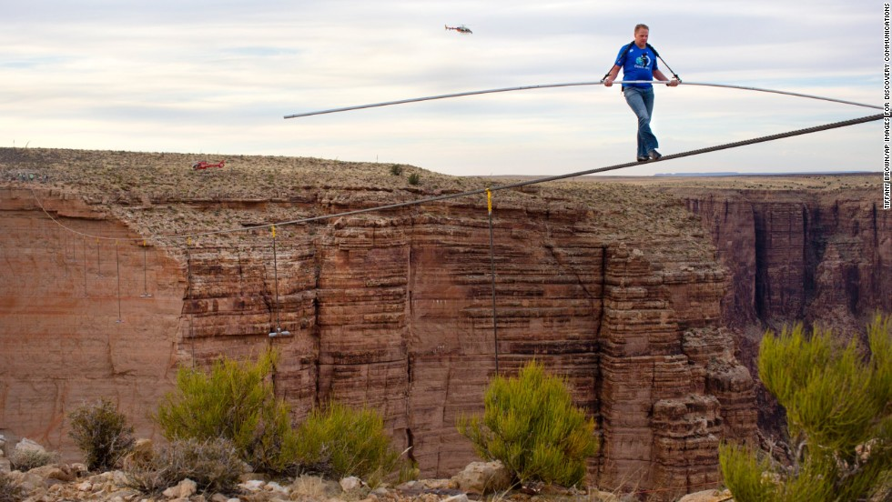 "Nik Wallenda nears the completion of his<a href=""http://www.cnn.com/2013/06/24/us/arizona-high-wire-wallenda/index.html""> quarter-mile walk near the Grand Canyon</a> in June 2013 in Arizona. He crossed the Little Colorado River Gorge without the aid of a safety tether. He is a member of the famous Flying Wallendas, founded by his great-grandfather Karl in the 1920s, and also walked across Niagara Falls last year."