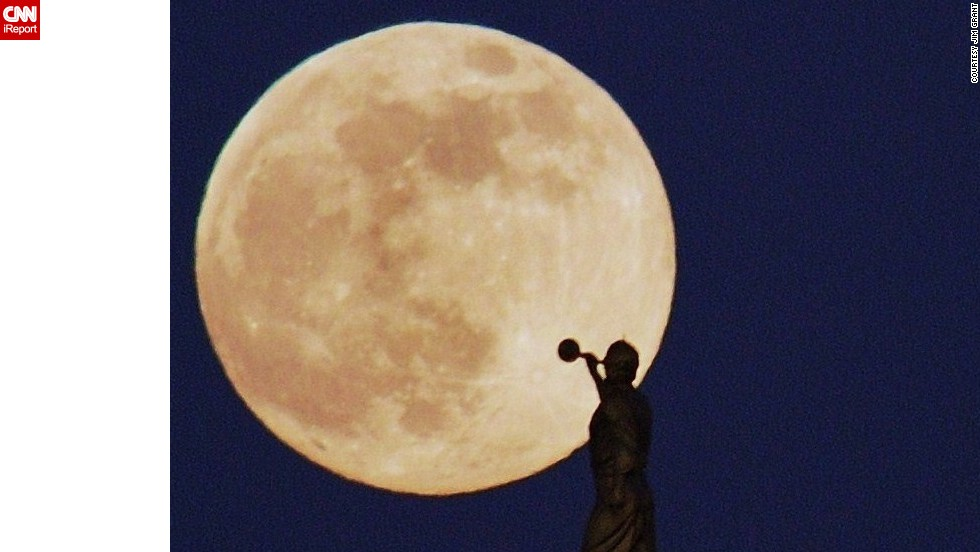 "<a href=""http://ireport.cnn.com/docs/DOC-993775"">Jim Grant </a>photographed the supermoon in the La Jolla area of San Diego. ""When I saw the moon rising, I thought I might have a good chance to get the trumpet player in the frame. So I pulled off the freeway into a shopping center and drove around looking for just the right angle,"" he said."