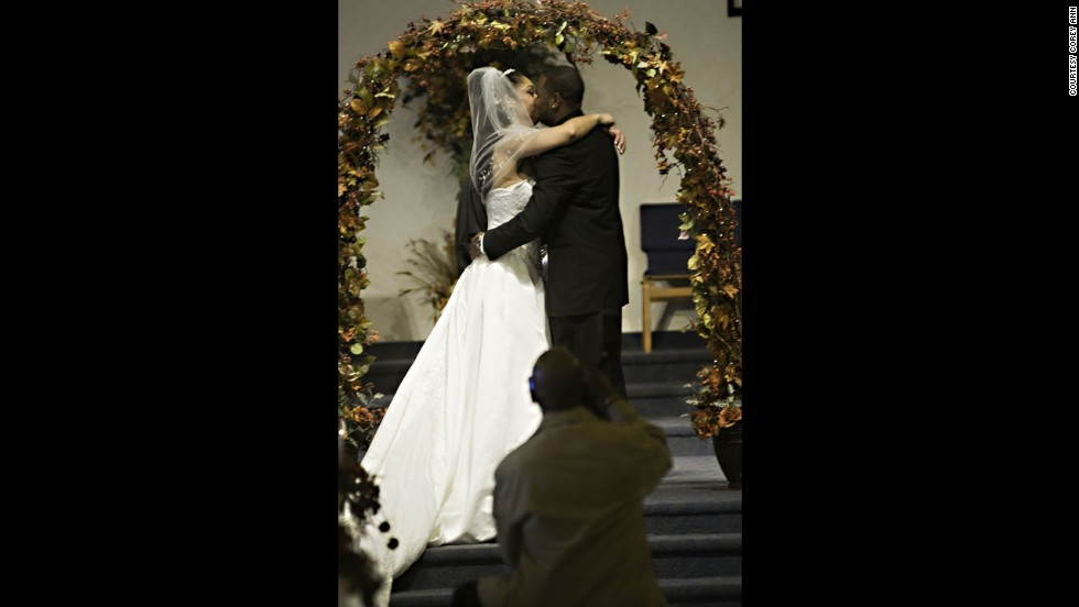 """When guests plant themselves right in front of the couple, there's only so much a photographer can do to get around them, Balazowich said. She was able to go to the sides to crop him out of most pictures but for the kiss, but """"the center shot is the one people want,"""" she said."""