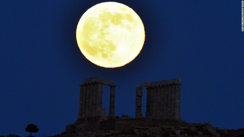 "JUNE 24 - CAPE SOUNION, GREECE: <a href=""http://www.cnn.com/2013/06/22/us/supermoon-sunday/index.html"">A Supermoon</a> rises next to the ancient Greek temple of Poseidon at Cape Sounion, approximately 65 kilometers south of Athens, on June 23. A Supermoon happens when the moon is full and at the same time reaches its perigee -- the closest point to Earth in its orbit, <a href=""http://www.cnn.com/2013/06/22/us/supermoon-sunday/index.html"">according to NASA.</a>"