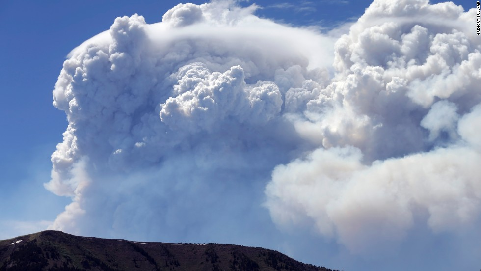 Plumes of smoke rise above Del Norte Peak in Colorado on Sunday, June 23. Fires have been burning across Colorado since early June.