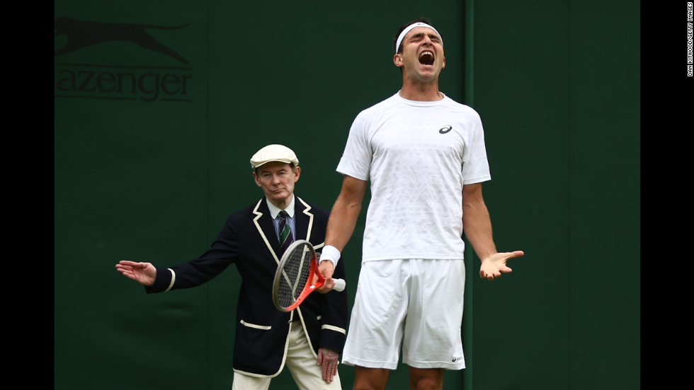 Marinko Matosevic of Australia reacts during his match against Guillaume Rufin of France on June 24. Rufin won 6-1, 4-6, 7-4, 6-3.