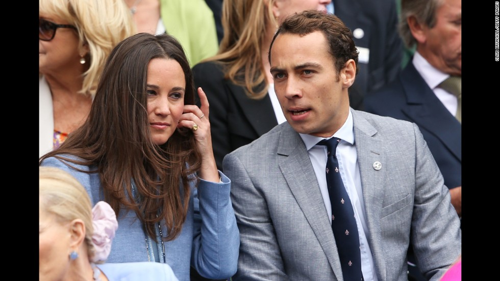Pippa Middleton and James Middleton, siblings of Catherine, Duchess of Cambridge, talk during the match between Hanescu and Federer on June 24.