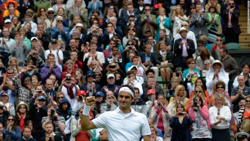 Switzerland's Roger Federer celebrates after defeating Romania's Victor Hanescu 6-3, 6-2, 6-0 during their men's first-round match on June 24.