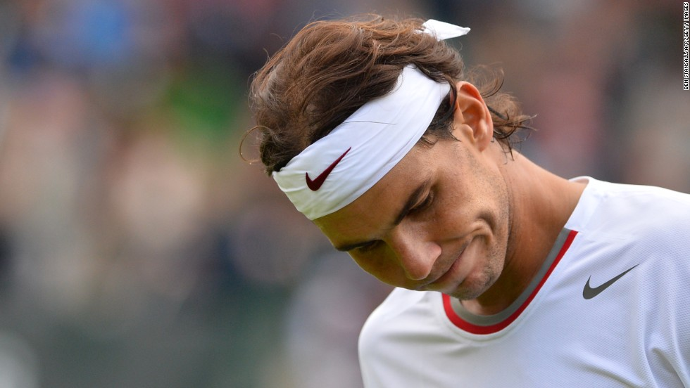 "In an opening-round upset, <a href=""http://bleacherreport.com/articles/1682893-rafael-nadal-upset-by-steve-darcis-at-2013-wimbledon"" target=""_blank"">Spain's Rafael Nadal lost to Belgium's Steve Darcis</a> 7-6 (7-4), 7-6 (10-8), 6-4 on June 24. It marks the first time Nadal has been eliminated in the first round of a Grand Slam event. He was eliminated in the second round of Wimbledon last year."