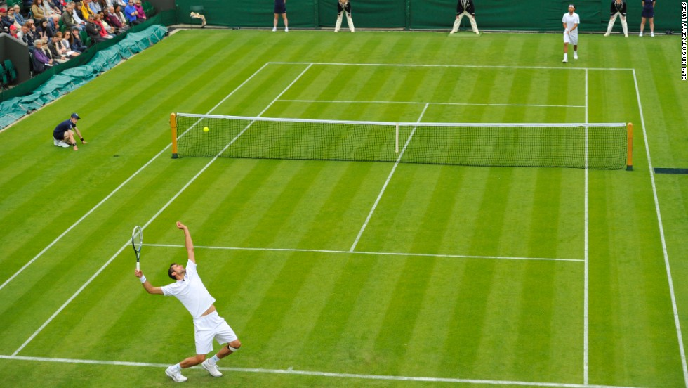 Croatia's Marin Cilic serves against Cyprus' Marcos Baghdatis on his way to victory in their first-round match on June 24. Cilic won 6-3, 6-4, 6-4.