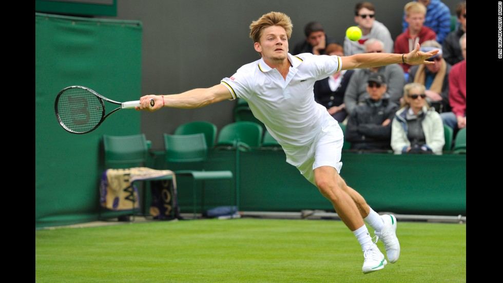 Belgium's David Goffin returns against France's Jo-Wilfried Tsonga during their first-round match on June 24. Tsonga won in straight sets 7-6, 6-4, 6-3.