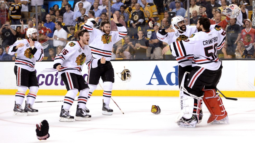The Chicago Blackhawks celebrate on the ice after defeating the Boston Bruins in Game 6.