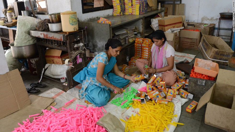 Workers pack candles at a factory in Ahmedabad, Gujarat state, on June 24.  Candles are in great demand during India's monsoon season as heavy rains cause electricity blackouts.