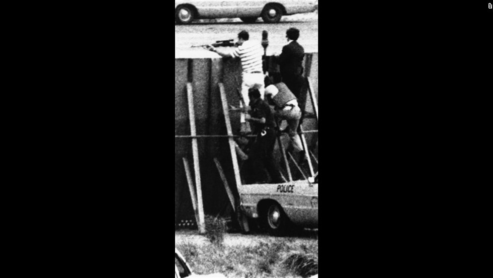 In 1971, a hijacker, tentatively identified as Richard Oberfell of Passaic, New .Jersey, forced a Chicago-bound plane to land at New York's LaGuardia Airport. He then took two hostages in a maintenance truck on a nine-mile ride to JFK international airport. There, FBI agents climbed a protective wall as they hunted down the hijacker, who demanded a plane to take him to Italy. FBI agent Kenneth Lovin, dressed in a striped shirt, fired fatal shots that killed the hijacker.