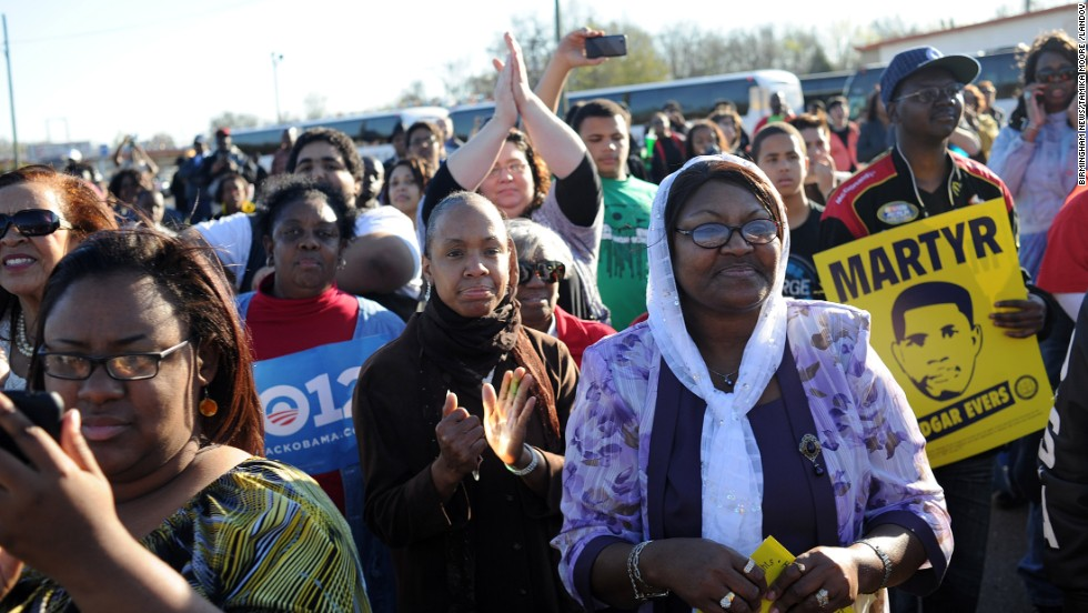 "A conservative judge called the Voting Rights Act a racial entitlement but supporters of the act say it is the crowning victory of the civil rights movement. Pictured, people gather for a post-march rally after crossing the Edmund Pettus Bridge on the ""Bloody Sunday"" anniversary, March 4, 2012."