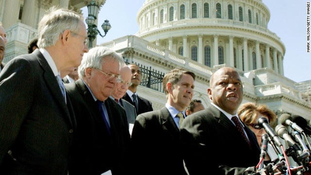 WASHINGTON - MAY 02:  U.S. Representative John Lewis (D-GA) (R) speaks while flanked by Senate Minority Leader Harry Reid (D-NV) (L), House Speaker Dennis Hastert (R-IL) (2nd-L), Senate Majority Leader Bill Frist (R-TN) (C) and other officials during a media conference on Capitol Hill May 2, 2006 in Washington, DC. The bipartisan House and Senate officials met to voice support for legislation to reauthorize the Voting Rights Act for an additional 25 years.  (Photo by Mark Wilson/Getty Images)