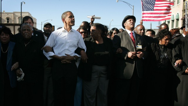 SELMA, AL - MARCH 4:  Democratic Presidential candidate Senator Barack Obama (D-IL) (3rd-L) marches with a crowd to the Edmund Pettus Bridge to commemorate the 1965 Bloody Sunday Voting Rights March March 4, 2007 in Selma, Alabama. During the 1965 march, which was to go from Selma to Montgomery, Alabama, police used tear gas and beat back the marchers when they reached the Pettus Bridge.  (Photo by Scott Olson/Getty Images)