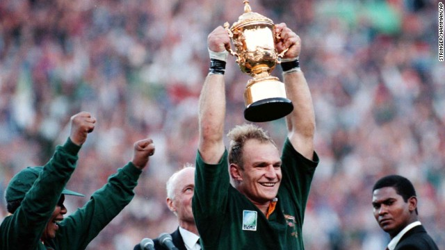 South Arican President Nelson Mandela, left, cheers as Springbok Rugby captain Francois Pienaar holds the trophy high after winning the World Cup Rugby Championship in Johannesburg on June 24 1995.  (AP Photo/Str/Hamman) SOUTH AFRICA OUT
