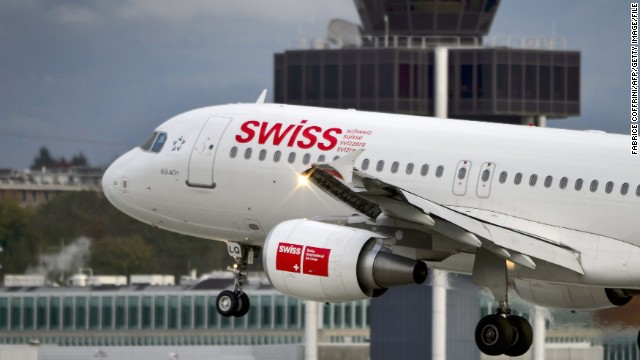An Airbus A320 plane of Swiss International Air Lines is landing on November 12, 2012 in Geneva. The company owned by German airline Lufthansa said it would cut flights to Athens and Madrid, both hard-hit by the eurozone crisis, and would expand its flights to more lucrative destinations.  AFP PHOTO / FABRICE COFFRINI        (Photo credit should read FABRICE COFFRINI/AFP/Getty Images)