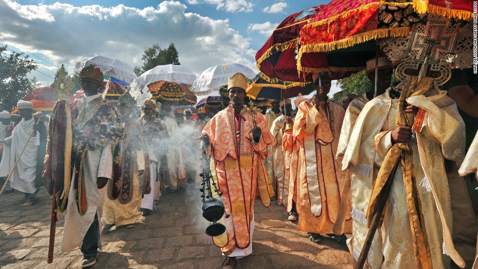 Priests and monks in Lalibela celebrate the Ethiopian Orthodox festival of Timkat, which remembers the Baptism of Jesus in the Jordan River. The Tabot, a model of the Ark of the Covenant is taken out of every Ethiopian church for 24 hours and paraded during a procession in towns across the country. Over 80 % of Ethiopians are estimated to be Orthodox Christians.