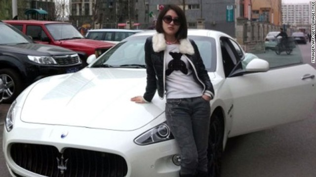 This photo posted by Guo Meimei on the Internet in 2011 shows her posing with a fancy sports car.