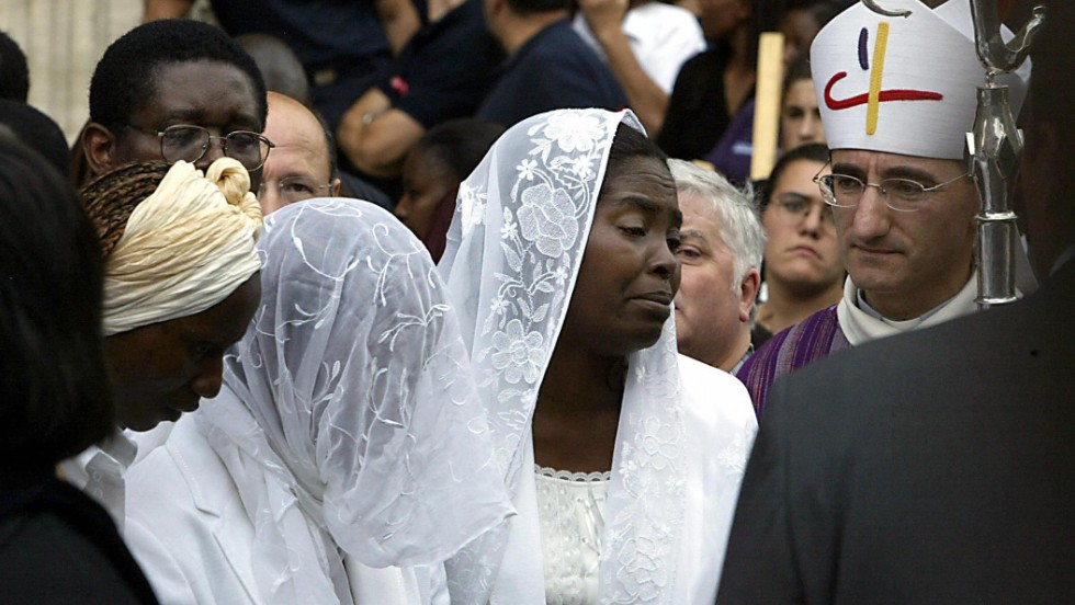 Marc-Vivien Foe's widow Marie-Louise, pictured at her late husband's funeral in the French city Lyon, has been at odds with the former Cameroon international's father Martin.