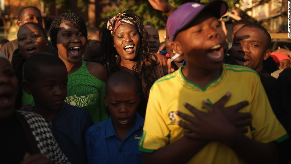 "JUNE 25 - PRETORIA, SOUTH AFRICA: Crowds near the hospital where Nelson Mandela has been hospitalized <a href=""http://cnn.com/2013/06/26/world/africa/mandela-hospital-messages/index.html"">sing songs and pray</a> <a href=""http://cnn.com/2013/06/26/world/africa/mandela-hospital-messages/index.html"">for the ailing anti-apartheid icon</a>. Messages outside the clinic describe many <a href=""http://cnn.com/2013/06/26/world/africa/mandela-hospital-messages/index.html"">South Africans' fear</a> that he may not be with them much longer, as authorities have described <a href=""http://cnn.com/2013/06/26/world/africa/south-africa-mandela/index.html"">his condition as critical</a>."