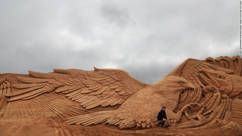 "Marjon Katerberg poses with ""Eagle Dance,"" at the<a href=""http://www.sandskulptur.dk"" target=""_blank""> International Sand Sculpture Festival.</a>"
