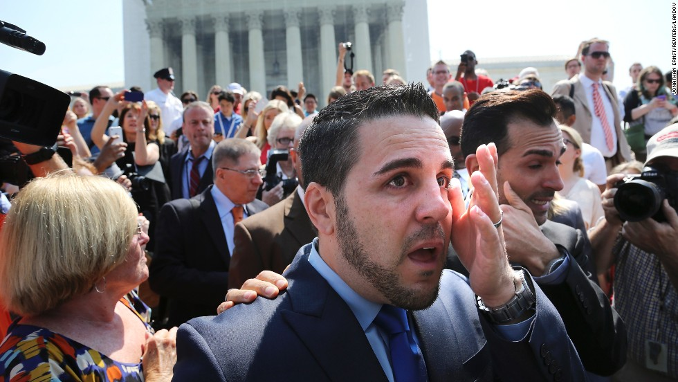 "Jeff Zarrillo, center, and Paul Katami, right, plaintiffs in the California case against Proposition 8, wipe away tears after departing the Supreme Court in Washington. <a href=""http://www.cnn.com/video/?/video/politics/2013/06/26/sot-dc-scotus-prop-8-proposal-katami-zarrillo.cnn"">Katami proposed to Zarrillo</a> on national news after the ruling."
