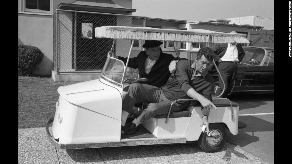 Frank Sinatra and Dean Martin tool around the Warner Bros. lot while making 1965's Marriage on the Rocks for the studio.