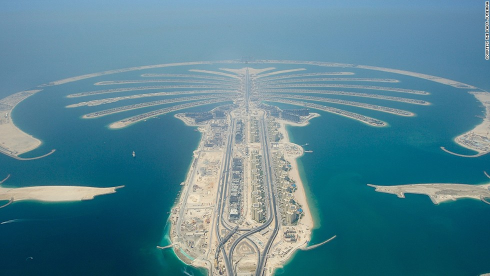 The Palm islands comprise approximately 100 million cubic meters of rock and sand. <br />In total, 210 million cubic meters of rock, sand and limestone were reclaimed (through dredging) to create the islands, with 10 million cubic meters of rock used in the outer ring alone. The rocks used for both islands were transported from 16 quarries throughout the UAE and the materials used are enough to build a wall that could circle the world three times. <strong>Completion date:</strong> September 24, 2008.
