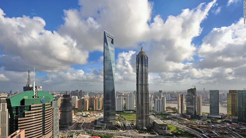 "The trapezoid-shaped opening near the top of the Shanghai World Financial Center reduces wind pressure on this 101-story-building.<br />When it was completed in 2008, the Shanghai World Financial Center became the second-tallest building in the world and the tallest building in mainland China, with a total height of 492 meters. Its most distinctive feature is its trapezoid, which is designed to reduce wind pressure and has earned the building the nickname ""bottle opener."" Visitors to the observation deck can purchase bottle openers in the shape of the building. <strong>Completion date: </strong>July 17, 2008."