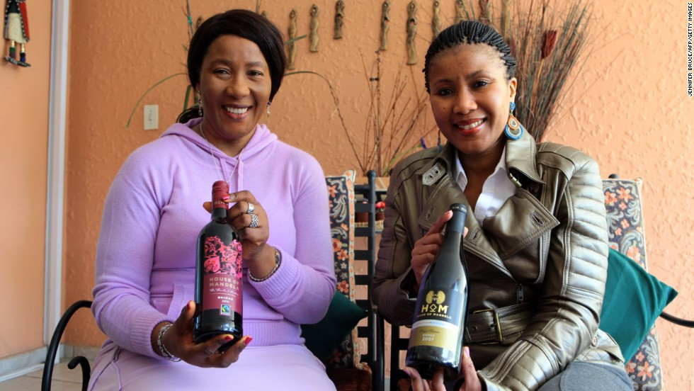 Nelson Mandela's daughter Makaziwe Mandela, left, with her daughter Tukwini Mandela, pose in April with House of Mandela wine at their home in Johannesburg.
