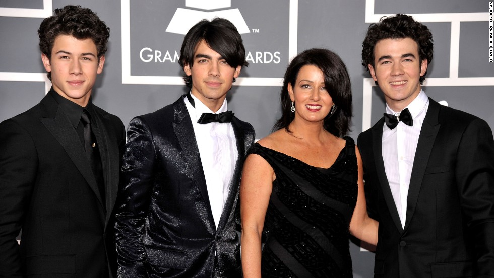 "Nick, Joe and Kevin Jonas, better known as the Jonas Brothers, attend the 2009 Grammy Awards with their mother, Denise Jonas. Denise often makes guest appearances on Kevin's E! reality show ""Married to Jonas."""