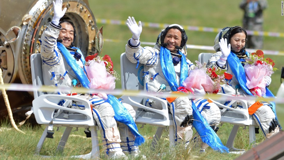 "JUNE 27 - BEIJING, CHINA: Astronauts (L-R) Zhang Xiaoguang, Nie Haisheng and Wang Yaping returned in the Shenzhou-10 spacecraft, landing in the north Inner Mongolia grasslands on June 26 after 15 days in space. <a href=""http://cnn.com/2013/06/27/world/asia/china-space-shenzhou-return/index.html"">This longest manned mission</a> is a major step towards Beijing's goal of building a permanent space station by 2020."